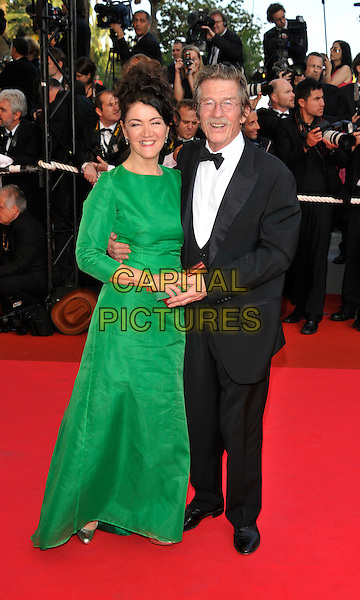 """ANN REES MEYERS, JOHN HURT.""""Indiana Jones and the Kingdom of the Crystal Skull"""" film premiere arrivals at Palais de Festival.61st Cannes International  Film Festival, France.18th May 2008 .full length wife bow tie dinner suit dj tuxedo green dress sequel 4 IV.CAP/PL.© Phil Loftus/Capital Pictures"""