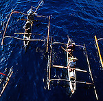 Elevated view of the shapes of outrigger canoes, that are used for inshore fishing around Bali and other Indonesian Islands.