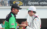 Jul. 4, 2008; Daytona Beach, FL, USA; NASCAR Sprint Cup Series driver Kyle Busch (right) talks with crew chief Steve Addington during qualifying for the Coke Zero 400 at Daytona International Speedway. Mandatory Credit: Mark J. Rebilas-