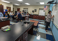 NWA Democrat-Gazette/ANTHONY REYES &bull; @NWATONYR<br /> Ixchel Reyes teaches physical science in the language academy, Monday, Sept. 14, 2015 at Har-Ber High School in Springdale. The high school has seen a rising student population with numbers exceeding 2,100 students. The school has added a number of teaching positions. Reyes teaches her class in a science lab instead of a standard classroom to accommodate the higher number of students versus classrooms available.