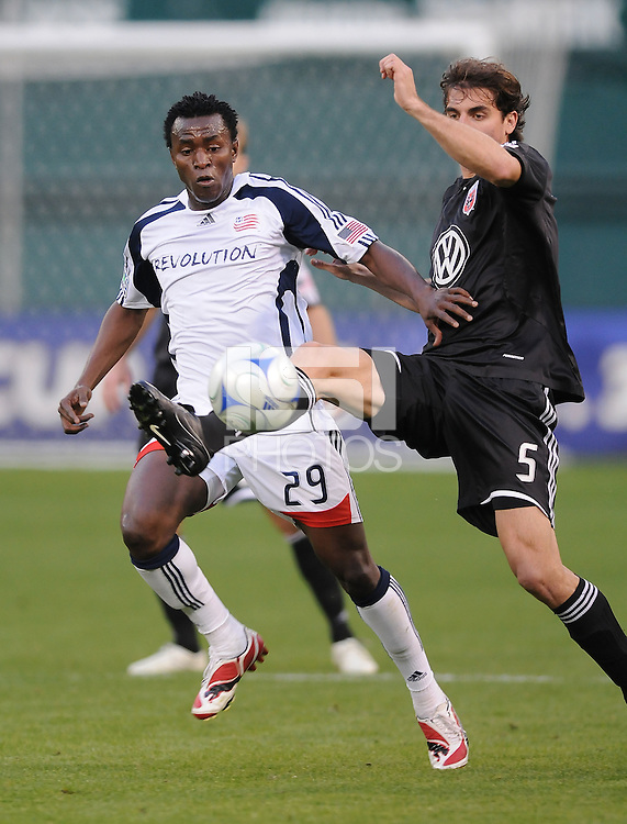 DC United defender Dejan Jakovic (5) shields the ball against New England Revolution forward Kenny Mansally (29) DC United tied The New England Revolution 1-1 at  RFK Stadium, Friday April 17, 2009.