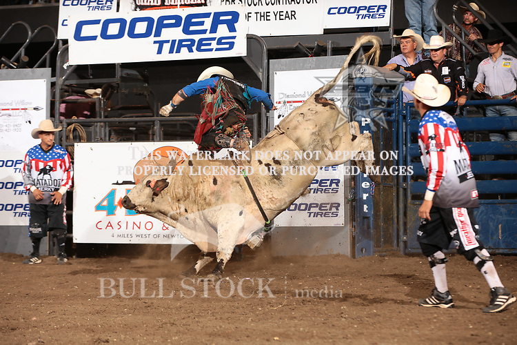 Cody Nance attempts to ride Dakota Rodeo-Chad Berger/Clay Struve/Miller's Catfish John during the Championship round of the Bismarck Real Time Pain Relief Velocity tour PBR. Photo by Andy Watson