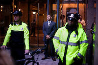 Police and security guards stand outside 125 High Street in the Financial District while protesters gather outside the building as part of the OccupyBoston demonstration in downtown Boston, Massachusetts, USA. The protesters are part of  OccupyBoston, which is part of the OccupyWallStreet movement, expressing discontent with the socioeconomic situation of the 99% of the US population who are not wealthy.  Protestors have been camping in Dewey Square since Sept. 30, 2011. Gradually, larger organizations, including major labor unions, have expressed their support for the OccupyBoston effort.  On this day, Oct. 5, members of National Nurses United, the largest nurses' union in the US, marched alongside the OccupyBoston protesters.