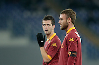 Calcio, ottavi di finale di Coppa Italia: Roma vs Atalanta. Roma, stadio Olimpico, 11 dicembre 2012..AS Roma midfielder Miralem Pjanic, of Bosnia, looks at his teammate Daniele De Rossi, right, during their Italy Cup last-16 tie football match between AS Roma and Atalanta at Rome's Olympic stadium, 11 december 2012. .UPDATE IMAGES PRESS/Riccardo De Luca