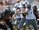 Duypo wide receiver Jake Taylor (right) tries to evade the tackle by Wesclin's Isaiah Burris. Wesclin defeated Dupo 34-30 on Saturday August 31, 2019 in a game that was stopped Friday night at halftime due to storms. <br /> Tim Vizer/Special to STLhighschoolsports.com