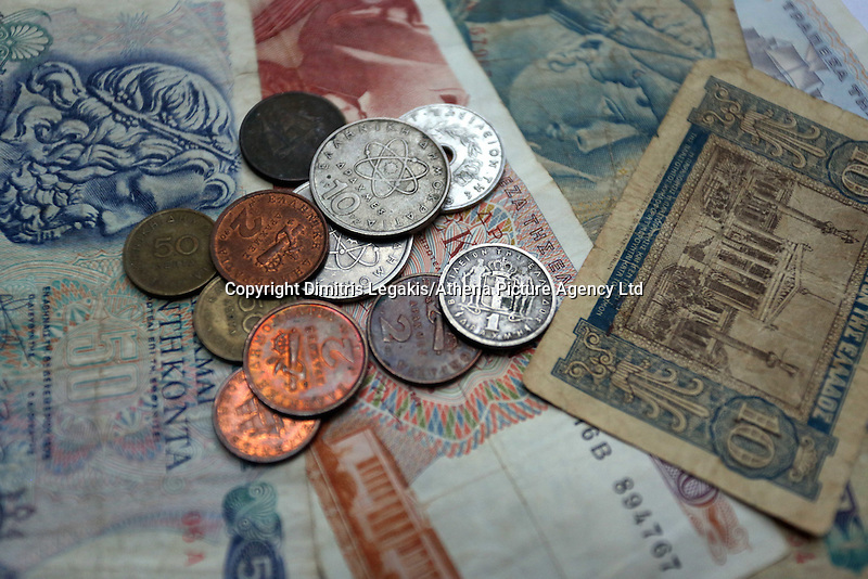 A mixture of old drachma coins and paper notes<br />