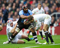 Akapusi Qera of the Flying Fijians is stopped by Thomas Waldrom (left) and Alex Goode of England during the QBE International between England and Fiji at Twickenham on Saturday 10th November 2012 (Photo by Rob Munro)