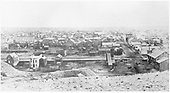 Densely build up 19th centry town from hill.  No railroad tracks.  Identifiable businesses: Powell House (Hotel), Bate &amp; Son (?) Store, E. Meyer Store.<br /> possible Leadville, CO