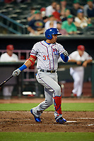 Round Rock Express first baseman Ronald Guzman (31) follows through on a swing during a game against the Memphis Redbirds on April 28, 2017 at AutoZone Park in Memphis, Tennessee.  Memphis defeated Round Rock 9-1.  (Mike Janes/Four Seam Images)
