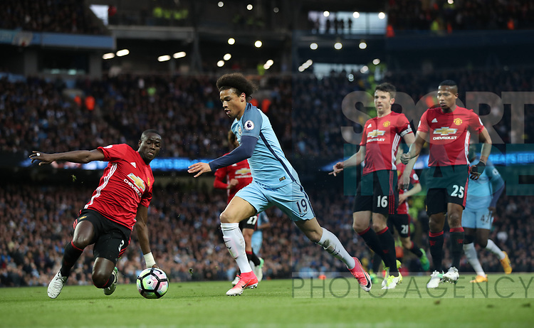 Leroy Sane of Manchester City and Eric Bailly of Manchester United during the English Premier League match at The Etihad Stadium, Manchester. Picture date: April 27th, 2016. Photo credit should read: Lynne Cameron/Sportimage
