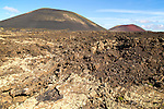 Malpais badlands volcanic landscape Montana Negra and Caldera Colorada, Parque Natural Los Volcanes, Masdache, Lanzarote, Canary islands, Spain