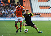 Blackpool's Liam Feeney is tackled by Macclesfield Town's Eddie Clarke<br /> <br /> Photographer Kevin Barnes/CameraSport<br /> <br /> The Carabao Cup First Round - Blackpool v Macclesfield Town - Tuesday 13th August 2019 - Bloomfield Road - Blackpool<br />  <br /> World Copyright © 2019 CameraSport. All rights reserved. 43 Linden Ave. Countesthorpe. Leicester. England. LE8 5PG - Tel: +44 (0) 116 277 4147 - admin@camerasport.com - www.camerasport.com