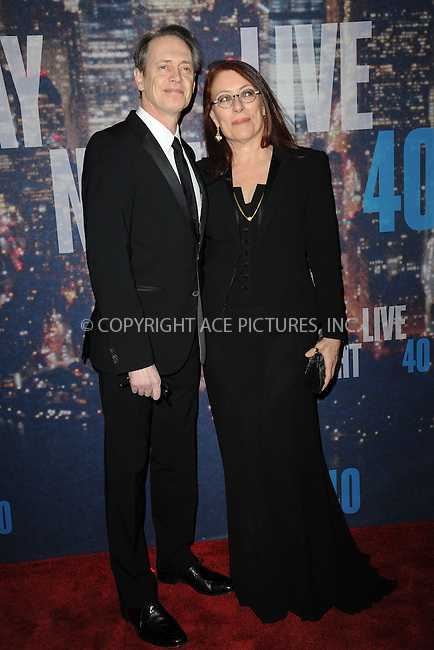 WWW.ACEPIXS.COM<br /> February 15, 2015 New York City<br /> <br /> Steve Buscemi,,Jo Andres walking the red carpet at the SNL 40th Anniversary Special at 30 Rockefeller Plaza on February 15, 2015 in New York City.<br /> <br /> Please byline: Kristin Callahan/AcePictures<br /> <br /> ACEPIXS.COM<br /> <br /> Tel: (646) 769 0430<br /> e-mail: info@acepixs.com<br /> web: http://www.acepixs.com