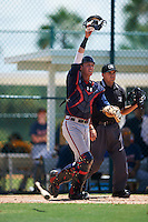 GCL Braves catcher Collin Yelich (30) and umpire Josh Gilreath keep their eye on the ball during a game against the GCL Pirates on August 10, 2016 at Pirate City in Bradenton, Florida.  GCL Braves defeated the GCL Pirates 5-1.  (Mike Janes/Four Seam Images)
