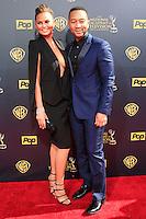 BURBANK - APR 26: Chrissy Teigen, John Legend at the 42nd Daytime Emmy Awards Gala at Warner Bros. Studio on April 26, 2015 in Burbank, California