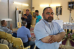 Mcc0070043 . Daily Telegraph<br /> <br /> DT News<br /> <br /> Father Martin Hermis Dawood leads prayers at the camp church every Saturday .<br /> <br /> The Virgin Mary Camp in Baghdad for Christians that escaped persecution in Mosul when ISIS took the city .<br /> <br /> Baghdad 13 May 2016