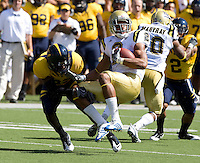 Josh Hill of California tackles Anthony Barr of UCLA during the game at Memorial Stadium in Berkeley, California on October 9th, 2010.   California defeated UCLA, 35-7.