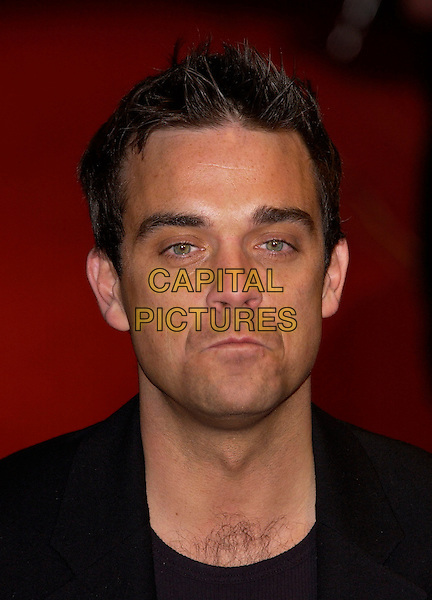 ROBBIE WILLIAMS.UK Music Hall of Fame.Hackney Empire.London 11 November 2004.Ref: PL.portrait headshot.www.capitalpictures.com.sales@capitalpictures.com.©Capital Pictures.