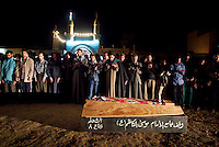 Baghdad, Iraq, March 28, 2003.A night prayer for 2 of the 52 victims of the unidentified missile that exploded at dusk in the middle of a crowded market in Al Shuala', a very poor area of North West Baghdad.