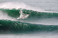 Surfer Ben Skinner surfing between two waves at The Cribbar, Newquay, on October 30th 2011 #11. Cornwall's legendary big wave only occurs under precise conditions of a huge swell, a very long swell period, a particular swell direction, and a southeast wind, meaning that it only appears 2 or 3 times a year.