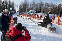 Justin Savidis and team in the chute leaving Willow, Alaska during the restart of the Iditarod sled dog race Sunday, March 3, 2013.