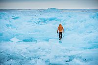 Ice bouldering along the frozen shores of Lake Superior at Marquette, Michigan on Michigan's Upper Peninsula.