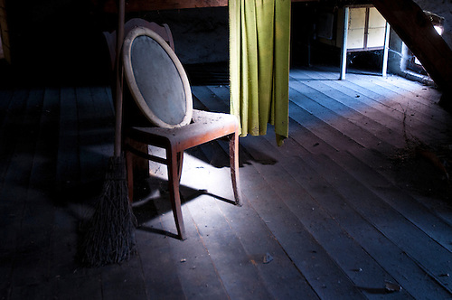 Old village mill, abandoned in East Germany. Old chair forgotten.