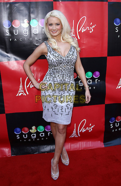 "Holly Madison.Holly Madison hosts a book signing for her new memoir, ""The Show Girl Next Door: Holly Madison's Las Vegas"", at Sugar Factory inside Paris Las Vegas, Las Vegas, Nevada, USA  .11th June 2011.full length white black print dress hand on hip  .CAP/ADM/MJT.© MJT/AdMedia/Capital Pictures"