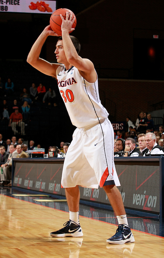 CHARLOTTESVILLE, VA- December 3: Thomas Rogers #30 of the Virginia Cavaliers handles the ball during the game on December 27, 2011 against the Longwood Lancers at the John Paul Jones Arena in Charlottesville, Virginia. Virginia defeated Longwood 86-53. (Photo by Andrew Shurtleff/Getty Images) *** Local Caption *** Thomas Rogers