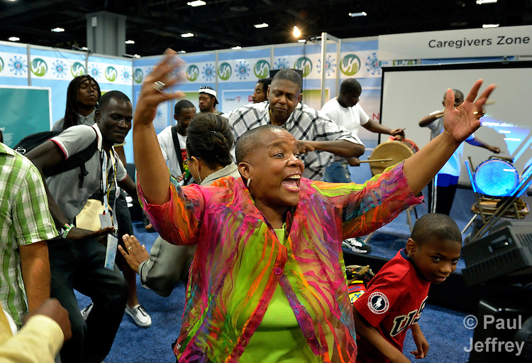 Pernessa Seele, founder of The Balm in Gilead, calls on people to join in dancing during a gathering in the Faith Zone of the Global Village at the XIX International AIDS Conference in Washington, D.C.  The Faith Zone was sponsored by the Ecumenical Advocacy Alliance.