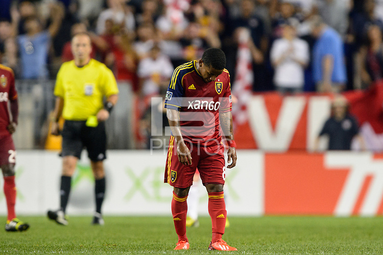 Joao Plata (8) of Real Salt Lake hangs his head after the Red Bulls scored in second half stoppage time. The New York Red Bulls defeated Real Salt Lake 4-3 during a Major League Soccer (MLS) match at Red Bull Arena in Harrison, NJ, on July 27, 2013.