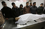 Relatives mourn over the body of Palestinian Mohammed Al- Dahdouh who was shot dead during clashes with Israeli troops, at a hospital morgue in Gaza city December 24, 2017. Al- Dahdouh who was shot during clashes with the Israeli troops the previous last week. Photo by Mohammed Asad