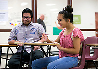 NWA Democrat-Gazette/JASON IVESTER<br /> Mia Preston, 14, of Fort Worth, Texas, fills out a questionnaire Friday, June 9, 2017, alongside her uncle Sheldon Riklon (cq), Jr., of Fayetteville at Springdale High School. UAMS hosted an event for Pacific Islander high school students and their parents to encourage the students to go into health care jobs.