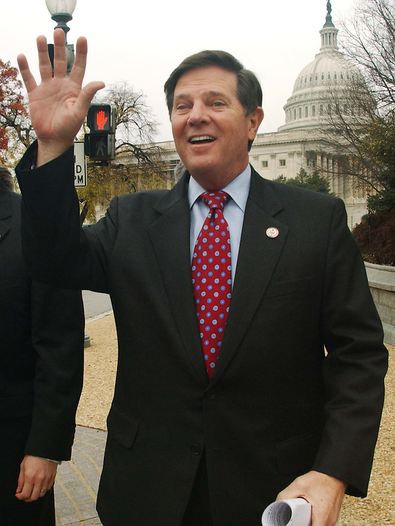"11/19/04.DELAY/ETHICS--House Majority Leader Tom DeLay, R-Texas, waves to members across Independence Avenue waiting to join him for a news conference on the House Committee on Standards of Official Conduct rebuke yesterday of outgoing Rep. Chris Bell, D-Texas,  who initiated an ethics complaint against DeLay. The admonishment of Bell came six weeks after the panel rebuked DeLay for actions related to two of the matters cited in Bell's complaint. The ethics panel found Bell in violation of a rule that an ethics complaint ""shall not contain innuendo, speculative assertions, or conclusory statements."".CONGRESSIONAL QUARTERLY PHOTO BY SCOTT J. FERRELL"