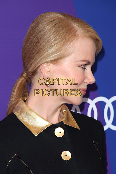 Nicole Kidman<br /> at Variety's 5th Annual Power of Women event presented by Lifetime at the Beverly Wilshire Four Seasons Hotel in Beverly Hills, California, USA, October 4th 2013.<br /> portrait headshot ponytail side profile collar black leather gold dress coat buttons <br /> CAP/MPI/mpi25<br /> &copy;mpi25/MediaPunch/Capital Pictures