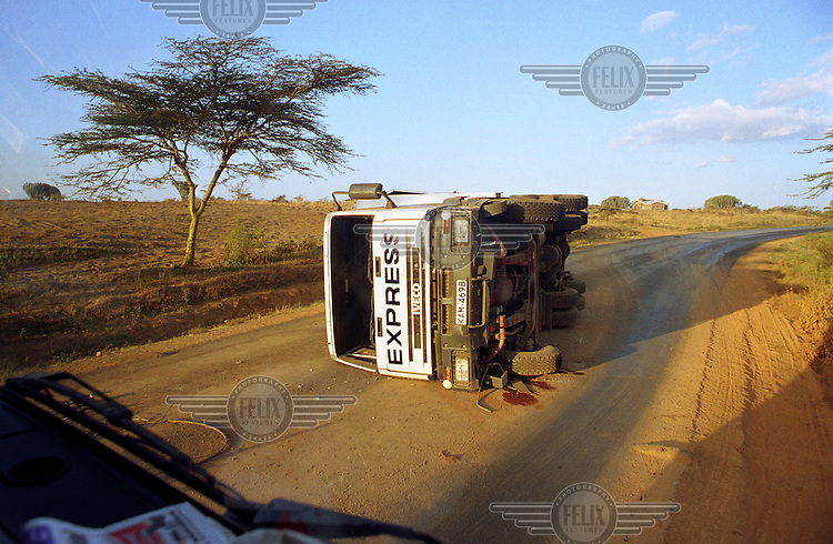 An overturned truck on a road.