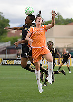 Kandace Wilson (left) heads the ball against Heather O'Reilly (right). FC Gold Pride defeated Sky Blue FC 1-0 at Buck Shaw Stadium in Santa Clara, California on May 3, 2009.