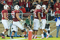 STANFORD, CA - NOVEMBER 15, 2014: Austin Hooper celebrates his touchdown with teammates during Stanford's game against Utah. The Utes defeated the Cardinal 20-17 in overtime.