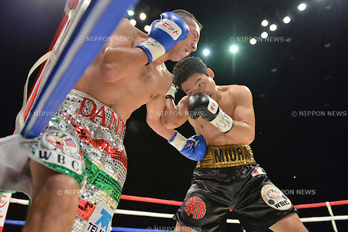 (L-R) Dante Jardon (MEX), Takashi Miura (JPN),<br /> DECEMBER 31, 2013 - Boxing :<br /> Dante Jardon of Mexico hits Takashi Miura of Japan during the first round of the WBC super featherweight title bout at Ota-City General Gymnasium in Tokyo, Japan. (Photo by Hiroaki Yamaguchi/AFLO)