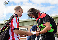 Lincoln City's Michael Bostwick signs an autograph for a fan<br /> <br /> Photographer Chris Vaughan/CameraSport<br /> <br /> The EFL Sky Bet League Two - Lincoln City v Morecambe - Saturday August 12th 2017 - Sincil Bank - Lincoln<br /> <br /> World Copyright &copy; 2017 CameraSport. All rights reserved. 43 Linden Ave. Countesthorpe. Leicester. England. LE8 5PG - Tel: +44 (0) 116 277 4147 - admin@camerasport.com - www.camerasport.com