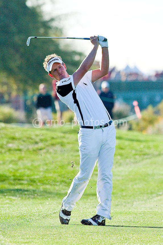 Feb 1, 2009; Scottsdale, AZ, USA; Luke Donald (GBR) hits his approach shot into the 1st hole during the final round of the FBR Open at the TPC Scottsdale.  Mandatory Credit: Chris Morrison-US PRESSWIRE