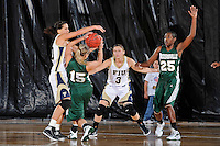 11 November 2011:  FIU's Fanni Hutlassa (10) prevents Jacksonville's Maggie Wilson (15) from shooting as FIU's Zsofia Labady (3) and Jacksonville's Jane'l Osborne (25) look on in the second half as the FIU Golden Panthers defeated the Jacksonville University Dolphins, 63-37, at the U.S. Century Bank Arena in Miami, Florida.