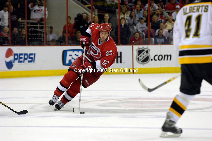 Carolina Hurricanes' Eric Staal (12) brings the puck up ice during a game with the Boston Bruins Saturday, Feb. 3, 2007 at the RBC Center in Raleigh. Boston won 4-3 in overtime.