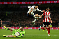 9th November 2019; Tottenham Hotspur Stadium, London, England; English Premier League Football, Tottenham Hotspur versus Sheffield United; Son Heung-Min of Tottenham Hotspur hurdles over Dean Henderson of Sheffield United - Strictly Editorial Use Only. No use with unauthorized audio, video, data, fixture lists, club/league logos or 'live' services. Online in-match use limited to 120 images, no video emulation. No use in betting, games or single club/league/player publications