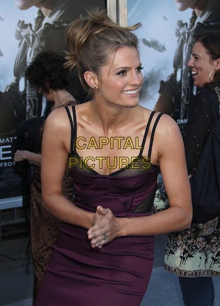 Stana Katic<br /> &quot;Elysium&quot; Los Angeles Premiere held at the Regency Village Theatre, Westwood, California, UK,<br /> 7th August 2013.<br /> half length corset dress purple black straps bustier hands<br /> CAP/ADM/RE<br /> &copy;Russ Elliot/AdMedia/Capital Pictures