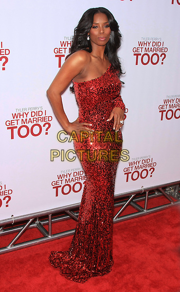 "TASHA SMITH .attending the Special New York Screening of ""Why Did I Get Married Too?"" held at the School of Visual Arts Theater, New York, NY,.March 22nd, 2010..full length red one shoulder long maxi dress hand on hip sequined sequin sleeve .CAP/LNC/TOM.©LNC/Capital Pictures."