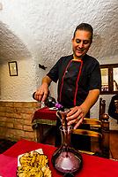 Chef Mario Perez decants a bottle of wine at his restaurant, La Tinaja, Guadix, Granada Province, Andalusia, Spain.