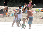 ..April 29th 2012   Exclusive   Sunday ...Alecia Moore Pink showing off her new hot beach body wearing a bikini top swimsuit in Malibu California playing in the water with her baby kid daughter Willow & husband .Carey Hart & friend & pro surfer STRIDER WASILEWSKI & his kid...AbilityFilms@yahoo.com.805-427-3519.www.AbilityFilms.com..