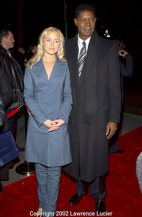 NEW YORK-NOVEMBER 5: Actor Dennis Haysbert (R) and girlfriend Jill Christiansen (L) arrive at the premier of the film Far From Heaven November 5, 2002, in New York City.