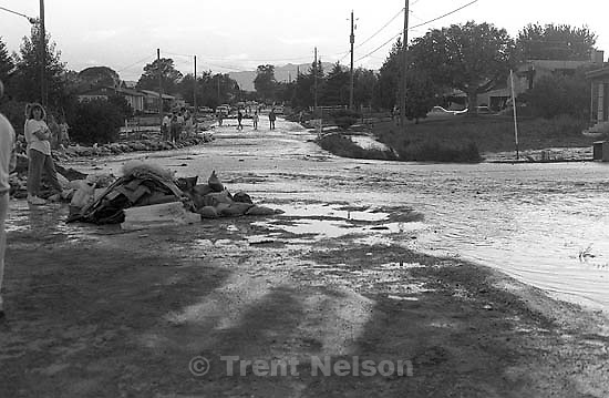 people and flooded street during flood.<br />